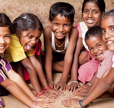 Group of Cheerful Rural Indian Children playing in a village in Maharashtra